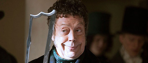 Tim Curry as Monro