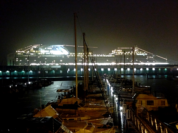 A cruise ship docked at the next pier looks like a space ship